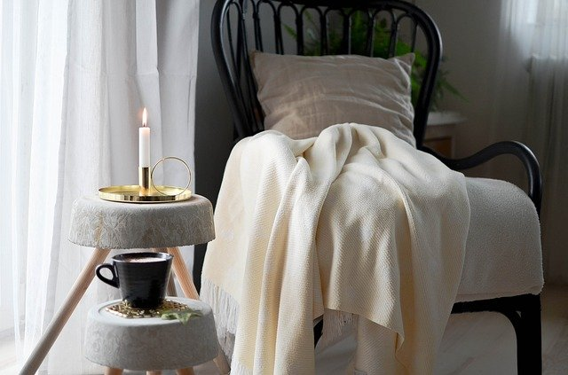 chair with blanket and candle hygge