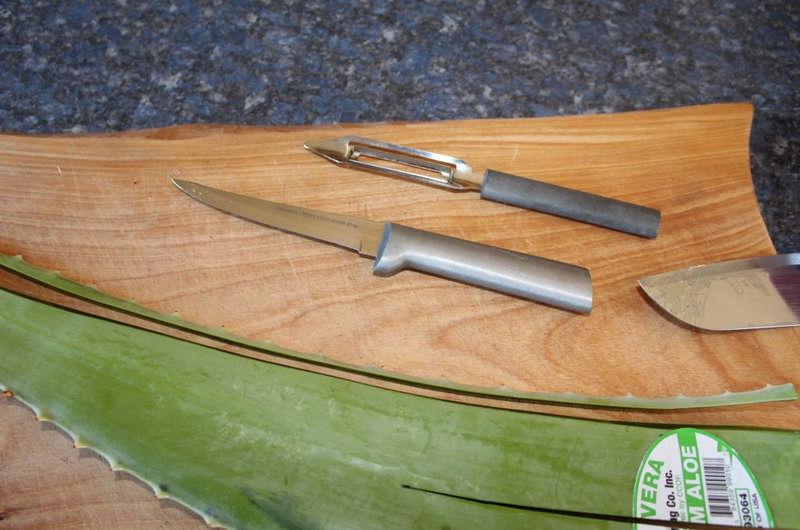 aloe vera leaf on cutting board
