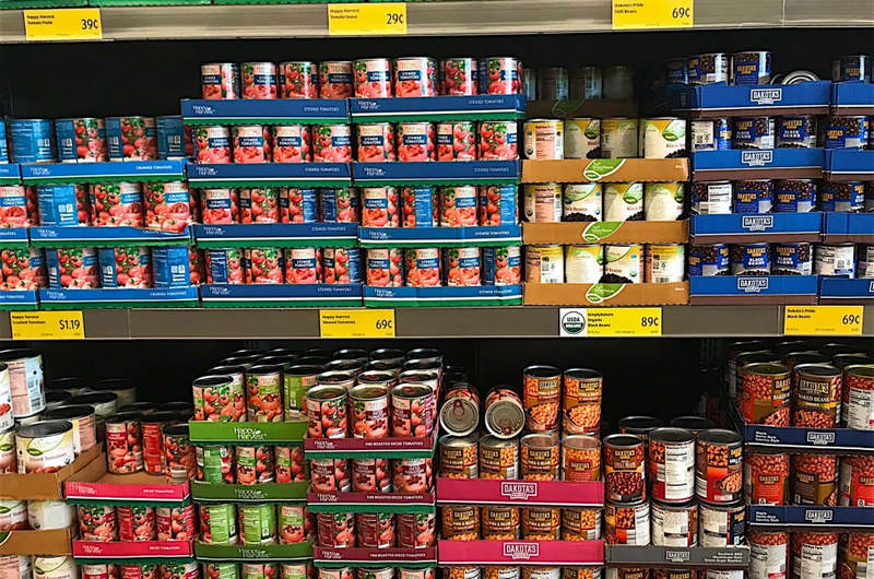 stocked pantry of canned food