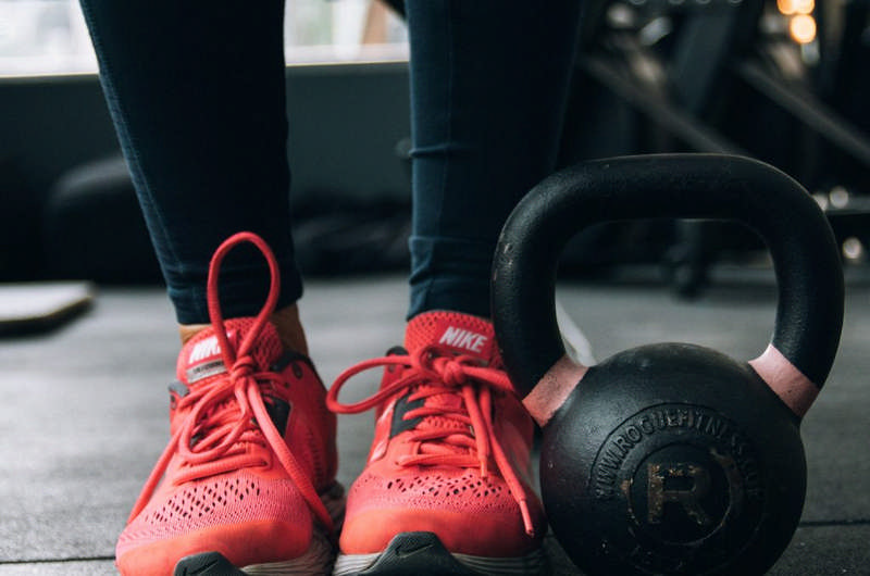 red work out shoes with a kettle bell