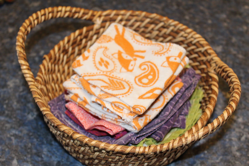 finished cloth napkins in a basket