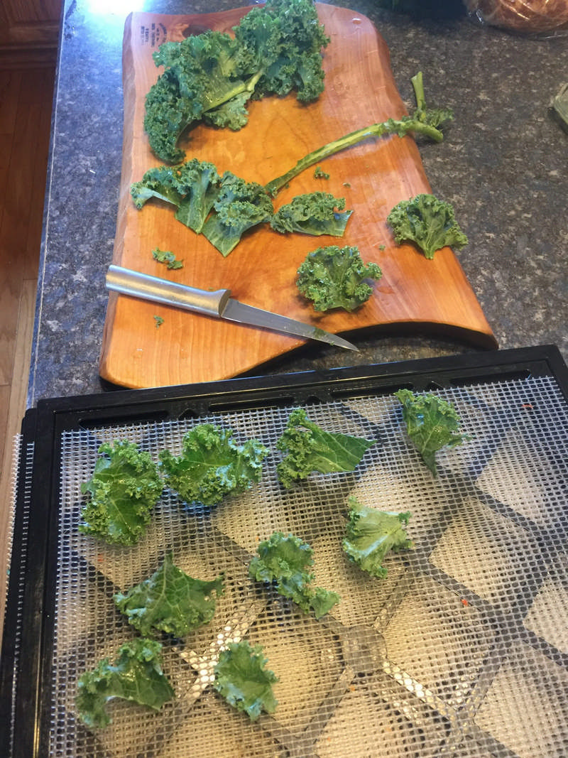 cutting kale on cutting board