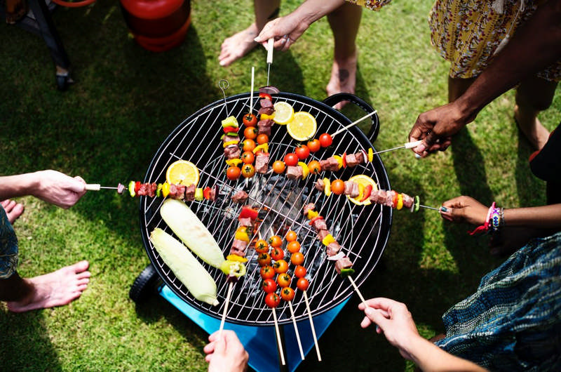 people grilling vegatables on open grill