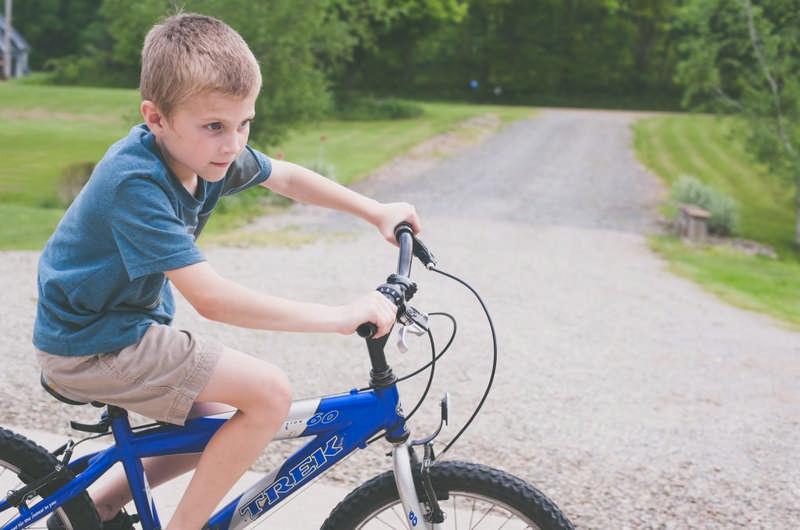 young boy riding bike