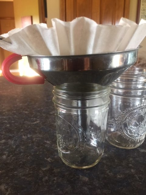 coffee filter over funnel