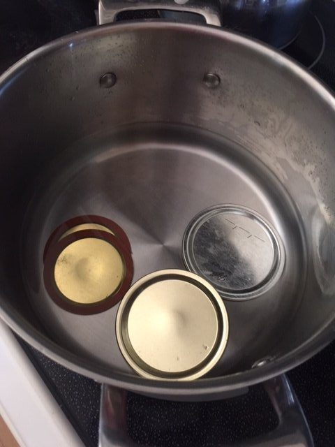 canning lids in sauce pan