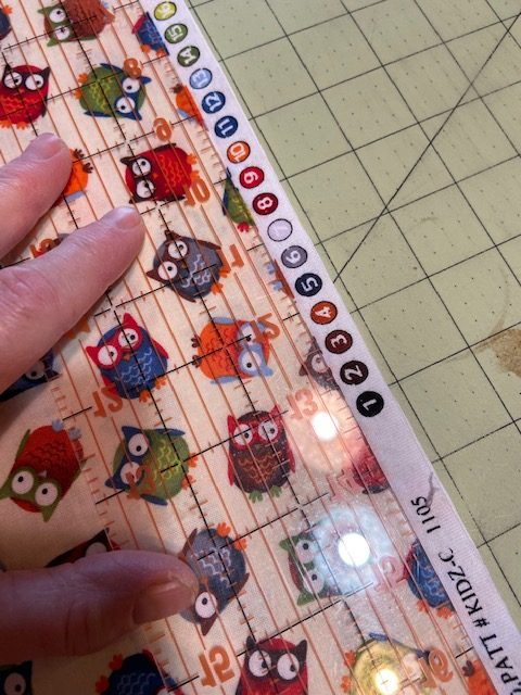 cutting owl fabric with ruler