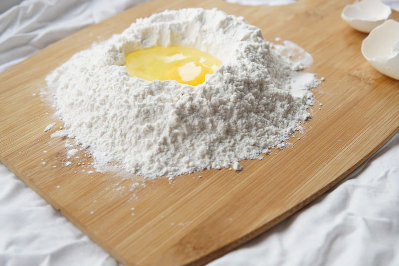 cutting board with flour and egg