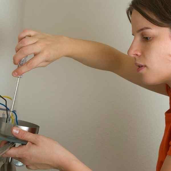 woman fixing something