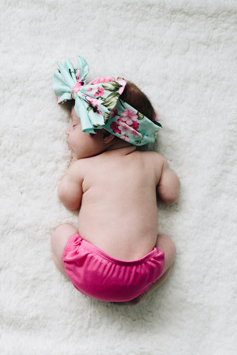 baby girl in pink cloth diaper
