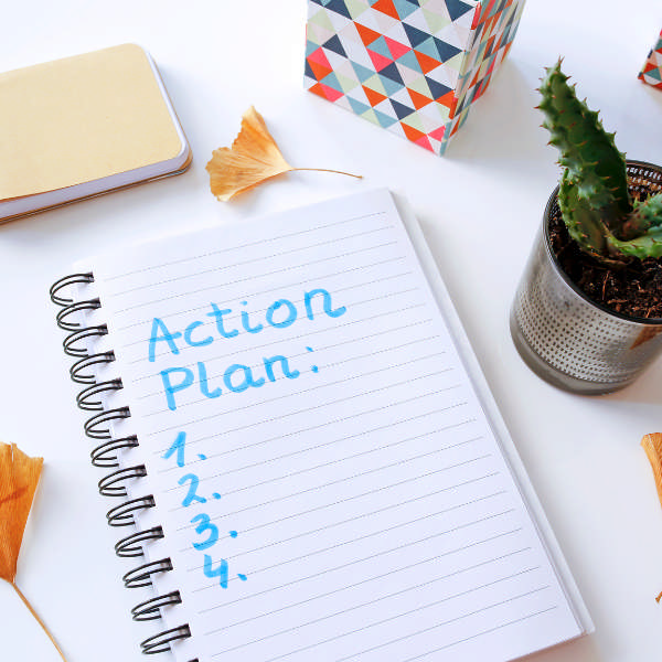 notebook with action plan
