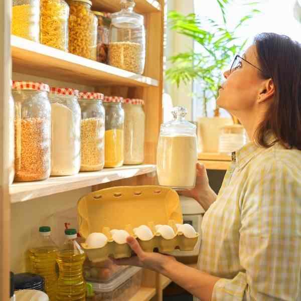 woman organizing food pantry