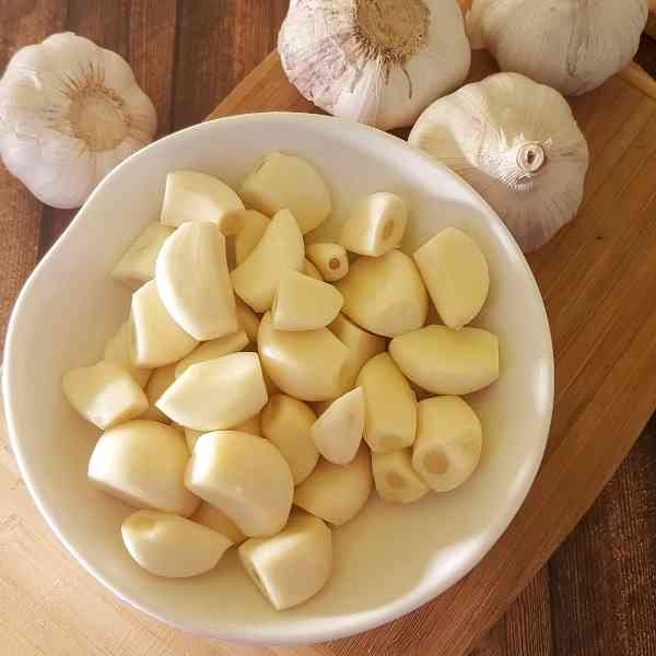 cloves of garlic in a bowl