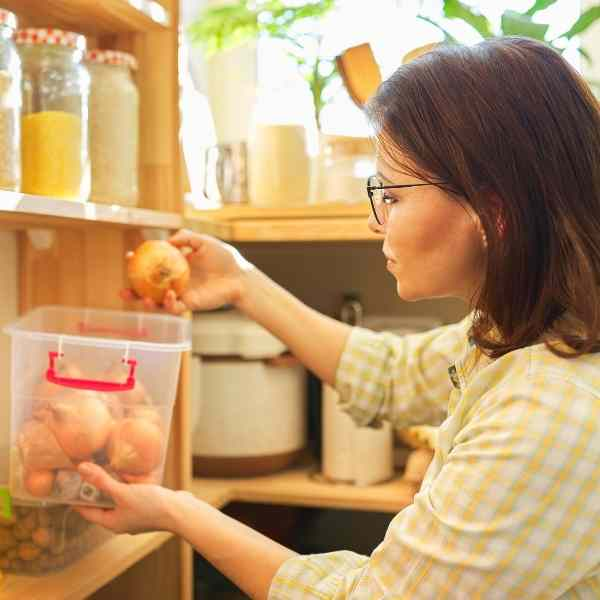 woman in pantry with onions