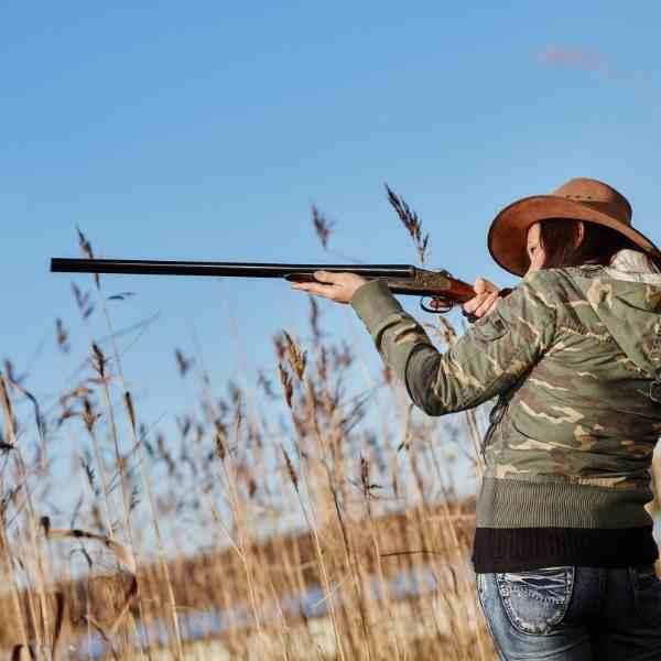 woman hunting iwth rifle
