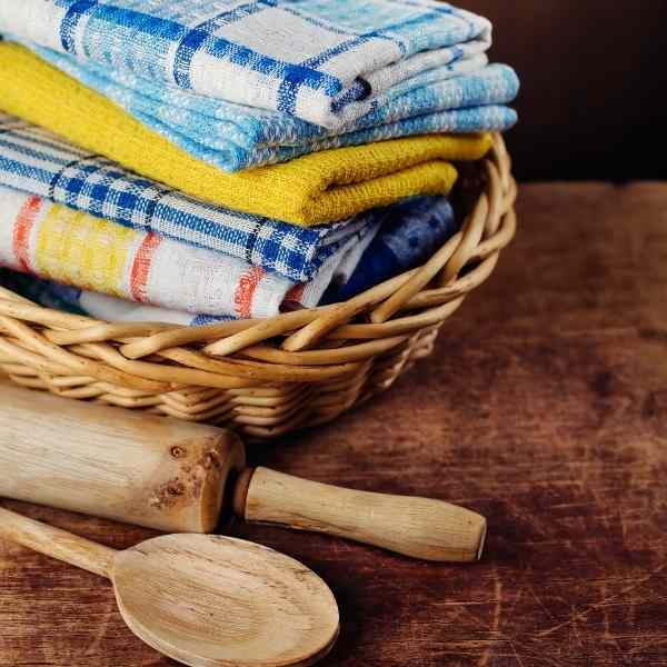 cloth kitchen towels in a basket