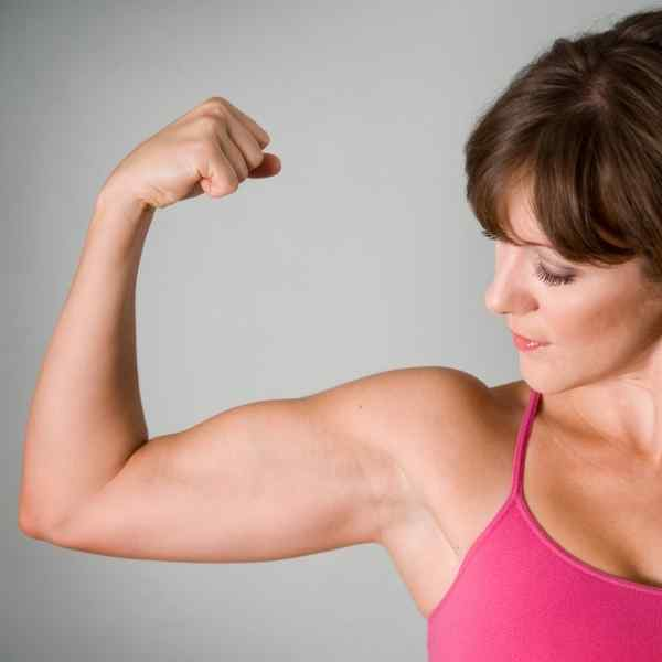 woman flexing her bicep