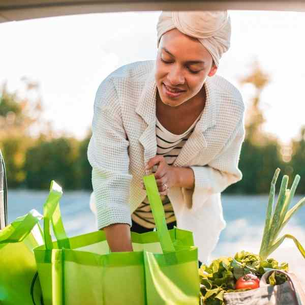 woman picking up groceries