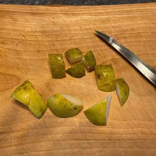chopping pears on cutting board